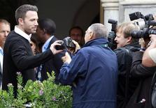 "<p>Actor Ben Affleck (2nd L), director of the out-of-competition film ""The Town"", takes a camera from a photographer as he arrives at the Excelsior Palace during the 67th Venice Film Festival September 7, 2010. REUTERS/Alessandro Bianchi</p>"