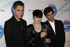 <p>British band The Xx pose for photographers with their award at the Mercury Prize awards in London September 7, 2010 REUTERS/Suzanne Plunkett</p>