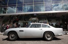 """<p>The original Aston Martin DB5, driven by actor Sean Connery in the James Bond films """"Goldfinger"""" and """"Thunderball"""", is seen parked in front of a hotel in London July 21, 2010. REUTERS/Suzanne Plunkett</p>"""
