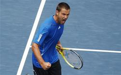 <p>Mikhail Youzhny of Russia celebrates a point in his match against Stanislas Wawrinka of Switzerland during the U.S. Open tennis tournament in New York September 9, 2010. REUTERS/Jessica Rinaldi</p>