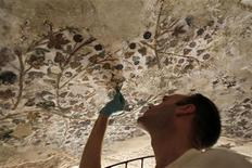 "<p>Stephen Rickerby, a British conservation specialist from the Courtald Institute in London, restores 2,000 year old Hellenstic style wall paintings in a cave complex, nicknamed ""Little Petra"", at Siq al-Barid in Beidha, about five km (three miles) away from the rock carved city of Petra, southern Jordan August 30, 2010. REUTERS/Ali Jarekji</p>"