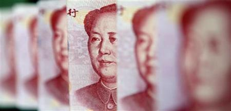 Yuan banknotes are seen in this illustrative photograph taken in Beijing July 26, 2010. REUTERS/Jason Lee