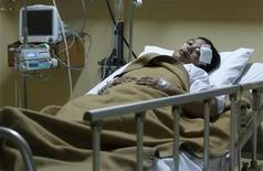 <p>Injured church priest Luspida Simanjutak lies in a hospital in Bekasi on the outskirts of Jakarta September 13, 2010. REUTERS/Crack Palinggi</p>