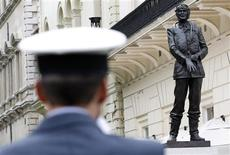 <p>A member of the Royal Air Force stands before a statue of World War Two era Air Chief Marshall Sir Keith Parker after its offical unveiling in London September 15, 2010. REUTERS/Stefan Wermuth</p>