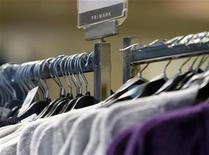 <p>Clothes hang on a rail at a Primark store in Loughborough, central England, November 4, 2008. REUTERS/Darren Staples</p>