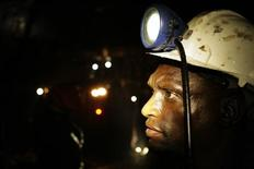 <p>A mine worker looks on underground in Johannesburg, February 3, 2009. REUTERS/Siphiwe Sibeko</p>