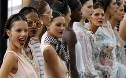<p>Models present creations by British designer Giles Deacon for Emanuel Ungaro as part of his Spring/Summer 2011 ready-to-wear women's fashion collection during Paris Fashion Week October 4, 2010. REUTERS/Pascal Rossignol</p>