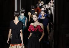 <p>Models present creations by Italian designer Stefano Pilati for Yves Saint Laurent as part of his Spring/Summer 2011 women's ready-to-wear collection during Paris Fashion Week October 4, 2010. REUTERS/Pascal Rossignol</p>