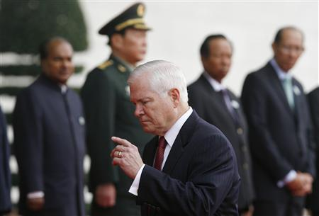 U.S. Defense Secretary Robert Gates (front) walks past (L-R) India's Defence Minister Shri AK Antony, China's Defence Minister Liang Guanglie, Cambodia's Defence Minister Tea Banh and Brunei's Deputy Defence Minister Mustappa Sirat before the first Association of Southeast Asian Nations (ASEAN) Defence Ministers Meeting Plus at the National Convention Center in Hanoi October 12, 2010. REUTERS/Kham