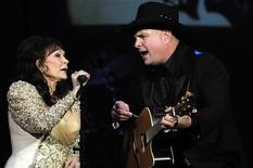 """<p>Country legend Loretta Lynn performs """"After the Fire is Gone"""" with country singer Garth Brooks during the Grammy Salute to Country Music honoring her in Nashville, Tennessee October 12, 2010. REUTERS/Tami Chappell</p>"""