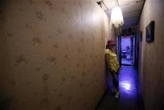 <p>Taiwan-born sex worker Niko, 47, poses for a photograph after an interview with Reuters inside a brothel in Taipei June 24, 2009. REUTERS/Nicky Loh</p>