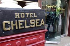 <p>A guest exits the Chelsea Hotel on West 23rd Street in New York, October 19, 2010. The New York hotel that inspired creative talent from Sir Arthur Clarke to Sid Vicious is up for sale. The hotel, controlled primarily by three families that have owned it for 65 years, will remain a haven for struggling artists despite changing hands, a hotel spokesman said. REUTERS/Brendan McDermid</p>