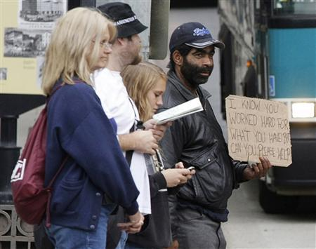 Harvey (R), a homeless man, begs for money along 14th Street in Washington October 20, 2010. In 2007, when the world was on the brink of financial crisis, U.S. income inequality hit its highest mark since 1928, just before the Great Depression. Economists are only beginning to study the parallels between the 1920s and the most recent decade to try to understand why both periods ended in financial disaster. Photo taken October 20, 2010. To match Special Report USA-ECONOMY/INEQUALITY. REUTERS/Stelios Varias (UNITED STATES - Tags: BUSINESS SOCIETY)