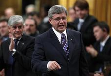 <p>Canada's Prime Minister Stephen Harper receives a standing ovation from his caucus while speaking during Question Period in the House of Commons on Parliament Hill in Ottawa October 27, 2010. REUTERS/Chris Wattie</p>