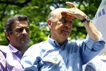 Presidential candidate Jose Serra (R) of the PSDB party and Senator Aecio Neves attend a campaign rally in Belo Horizonte October 30, 2010. REUTERS/Emmanuel Pinheiro