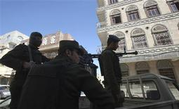 <p>Police troopers stand guard on a police vehicle outside a state security court in Sanaa November 2, 2010. REUTERS/Khaled Abdullah</p>