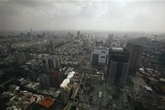 <p>An aerial view of Kaohsiung City in southern Taiwan August 27, 2009. Kaohsiung is Taiwan's second largest city and one of the world's busiest ports. REUTERS/Nicky Loh</p>
