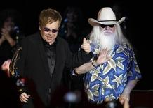 "<p>British musician Elton John (L) greets U.S. musician Leon Russell on stage at the start of their concert promoting their new album ""The Union"" at the Hollywood Palladium in Hollywood, California November 3, 2010. REUTERS/Fred Prouser</p>"