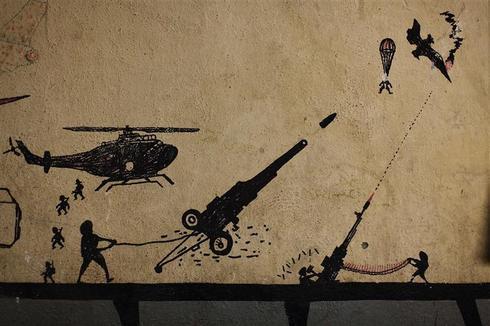 Taliban vs. U.S. graffiti
