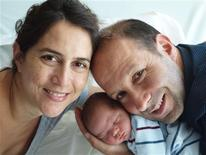 <p>Maria-Jose Poblete (L) poses with her husband Christophe Ferreira (R) and their son Mateo in Paris June 11, 2010. Poblete was born in Canada and raised in Chile and Ferreira was born in France. Their son Mateo, born in France in June, had to obtain Chilean citizenship through his grandparents because his foreign-born mother could not pass her citizenship on to him. Mateo is now French and Chilean. While it is hard to quantify how many professionals abroad are facing nationality trouble, International Organisation for Migration (IOM) spokesman Jean-Philippe Chauzy said citizenship laws were not designed for the international life that many professionals today are pursuing. Picture taken June 11, 2010. REUTERS/Handout</p>