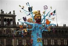 <p>An art installation representing a skeleton is seen at an altar assembled by artists for Day of the Dead celebrations at Zocalo's square in Mexico City October 29, 2010. REUTERS/Eliana Aponte</p>