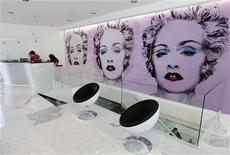 <p>Madonna posters are pictured on a wall at the reception of Hard Candy Fitness gym in Mexico City, November 27, 2010. REUTERS/Henry Romero</p>