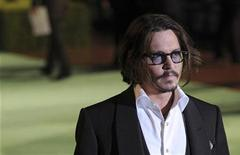 """<p>U.S. actor Johnny Depp poses for photographers as he arrives for the Royal World Premiere of """"Alice In Wonderland"""" at Leicester Square in London February 25, 2010. REUTERS/Jas Lehal</p>"""