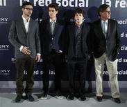 """<p>Justin Timberlake (L), Andrew Garfield and Jesse Eisenberg (2nd R) and writer Aaron Sorkin (R) pose during a photocall to promote the movie """"The Social Network"""" in Madrid, October 6, 2010. REUTERS/Andrea Comas</p>"""