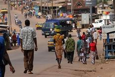 <p>People walk as security forces travelling in a truck patrol a street in Gagnoa in western Ivory Coast December 2, 2010. REUTERS/Luc Gnago</p>