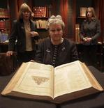 """<p>A Sotheby's employee poses with the first collected edition of Shakespeare's plays, known as the """"First Folio,"""" from 1623 at Sotheby's in London December 6, 2010. REUTERS/Suzanne Plunkett</p>"""