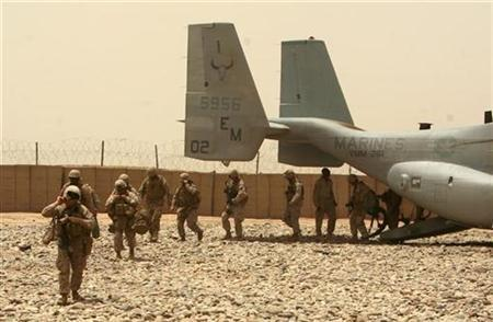 U.S. Marines from 3rd Battalion, 6th Marines leave a V-22 Osprey transport helicopter as they arrive at Sherwali camp in Marjah district, Helmand province May 22, 2010. REUTERS/Asmaa Waguih