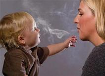 "<p>This handout image, released on November 10, 2010 depicts a mother blowing cigarette smoke in a child's face in one of the Federal Drug Administration's proposed new ""graphic health warnings."" Diseased lungs, dead bodies, a man on a ventilator and mothers blowing smoke in their children's faces are among the images unveiled that U.S. health officials are considering in their effort to revamp tobacco warning labels. REUTERS/HHS/Handout</p>"