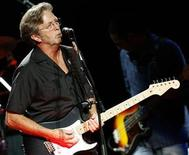 <p>Singer songwriter Eric Clapton performs at the Albert Hall in London May 16, 2009. REUTERS/Luke MacGregor</p>