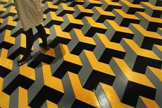 """<p>A visitor walks across a floor pattern from an installation entitled """"the wasteland"""" by Spanish artist Juan Munoz during the presentation of """"Juan Munoz: A Retrospective"""" at the Guggenheim Museum in Bilbao May 26, 2008. REUTERS/Vincent West</p>"""