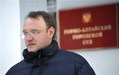 <p>Alexander Kalistratov, the local leader of a Jehovah's Witnesses congregation, arrives for a court session in the Siberian town of Gorno-Altaysk, December 16, 2010. Kalistratov now faces up to two years in prison if found guilty this week by a Russian court of inciting religious hatred for distributing literature about his beliefs. REUTERS/Alexandr Tyryshkin</p>