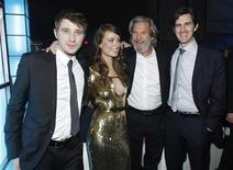 "<p>Cast members (L-R) Garrett Hedlund, Olivia Wilde, Jeff Bridges and director Joseph Kosinski pose together at the after party for the world premiere of the film ""TRON: Legacy"" in Hollywood, California, December 11, 2010. REUTERS/Danny Moloshok</p>"