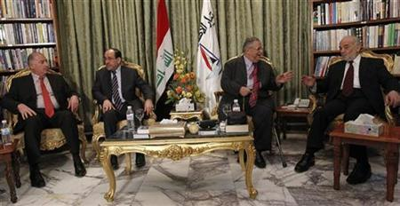 Iraqi parliament speaker Osama al-Nujaif (L) speaks with Iraq's Prime Minister Nuri al-Maliki (2nd L), Iraq's President Jalal Talabani (2nd R) and former prime minister and the head of Current National Reform Ibrahim al-Jaafari (R) before a media conference in Baghdad November 23, 2010. REUTERS/Thaier al-Sudani
