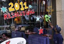 <p>A worker cleans the window of a restaurant ahead of New Year celebrations in Beirut December 31, 2010. REUTERS/ Mohamed Azakir</p>