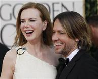 <p>Actress Nicole Kidman and her husband, musician Keith Urban, arrive at the 68th annual Golden Globe Awards in Beverly Hills, California, January 16, 2011. REUTERS/Mario Anzuoni</p>