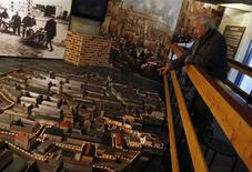 """<p>Matityahu Mintz looks at a model of the Warsaw Ghetto displayed at the """"From Holocaust to Revival"""" museum in Kibbutz Yad Mordechai in southern Israel January 18, 2011. Survivors of one the darkest episodes of the Nazi-era have turned to light-and-sound shows and walk-through mockups in the hope their memories will not fade away into the history books. At the museum, a scale model of the Warsaw ghetto shows where its Jews rose up against Hitler's troops in mid-1943, engaging in frantic house-to-house fighting in a bid to halt deportations to death camps. Picture taken January 18, 2011. REUTERS/Amir Cohen</p>"""