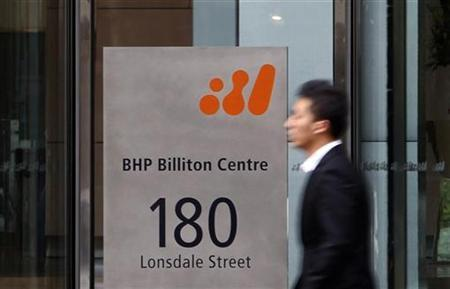 A man walks past the head office of BHP Billiton in central Melbourne October 18, 2010.REUTERS/Mick Tsikas