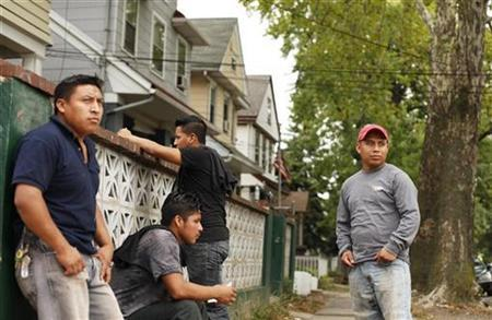 A group of immigrant day laborers stand near a street corner waiting for work in the Staten Island borough of New York August 3, 2010. REUTERS/Lucas Jackson
