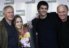 "<p>L-R: Director Peter Weir, actress Saoirse Ronan, actors Jim Sturgess and Ed Harris pose for photographers during the presentation of the film ""The way back"" in Madrid December 10, 2010. REUTERS/Andrea Comas</p>"