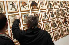 <p>Visitors view a wall of Saturday Evening Post magazine covers featuring the art of Norman Rockwell at the Dulwich Picture Gallery in London January 15, 2011. REUTERS/Chris Helgren</p>