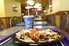 <p>An order of nachos is seen on a table at a Taco Bell fast food restaurant in New York December 7, 2006. REUTERS/Keith Bedford</p>