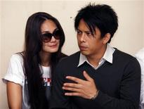"""<p>Indonesian pop singer Nazril """"Ariel"""" Irham (R) is accompanied by his television star girlfriend Luna Maya as he waits in a temporary detention cell before his verdict in Bandung of the Indonesia's West Java province January 31, 2011. The court sentenced him to jail for 3 years and 6 months over a controversial release of video clips appearing to show him and Maya having sex, breaching the country's controversial pornography law by allegedly appearing on widely circulated home-made sex videos. REUTERS/Enny Nuraheni</p>"""