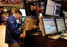 <p>A specialist trader rubs his eyes as he works on the floor of the New York Stock Exchange on the last trading day of the year in New York December 31, 2010. REUTERS/Jessica Rinaldi</p>
