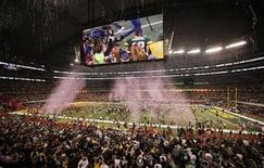 <p>Green Bay Packers' Aaron Rodgers is seen on the big screen as the Packers celebrate their win over the Pittsburgh Steelers during the NFL's Super Bowl XLV football game in Arlington, Texas, February 6, 2011. REUTERS/Gary Hershorn</p>