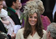 <p>Britain's Kate Middleton, girlfriend of Prince William, leaves following the wedding of Laura Parker Bowles and Harry Lopes at St Cyriac's Church in Lacock, in Wiltshire, west England, May 6, 2006. REUTERS/Toby Melville</p>