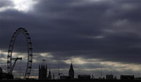 Clouds hang over Britain's Houses of Parliament, and the London Eye in central London January 28, 2011. REUTERS/Stefan Wermuth